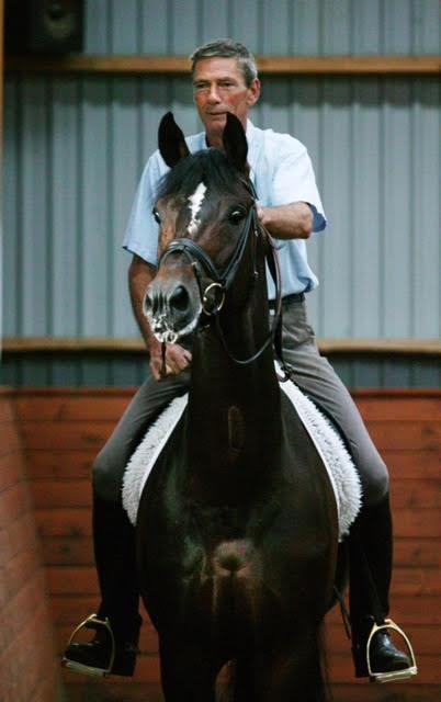 Jorgen Olsen riding the horse Milan in Dressage.